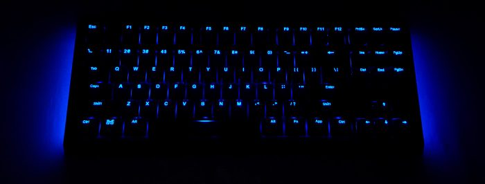 Showing off the ambient lighting and backlit keys in a dark room