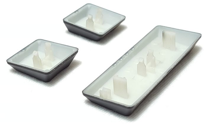 Two prongs used for attaching keycap to switch