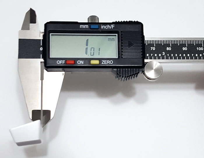 Measuring keycap thickness with a caliper