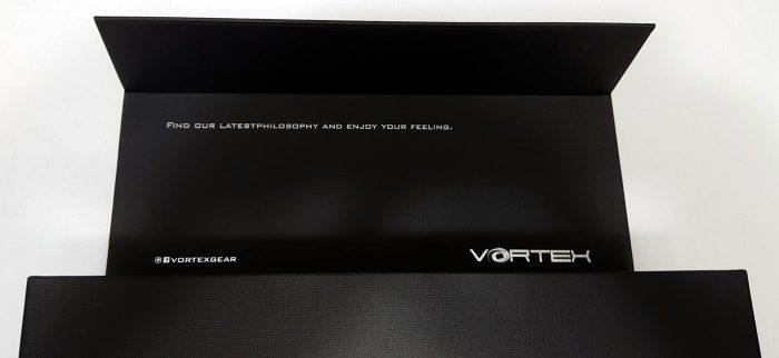 Box lid open showing slogan