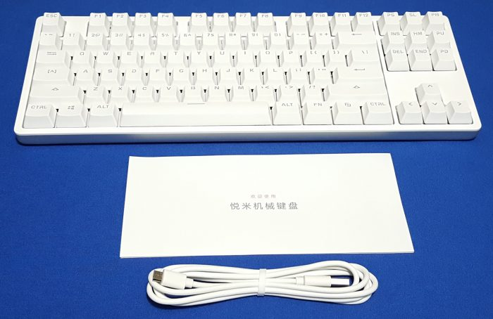 Unboxed keyboard, documentation and Micro USB cable