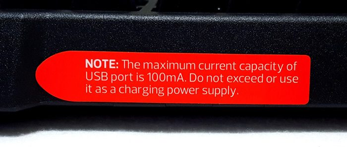 Warning sticker indicating max capacity of USB hub ports