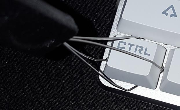 Twist wires until keycap corners are inside wire loops.